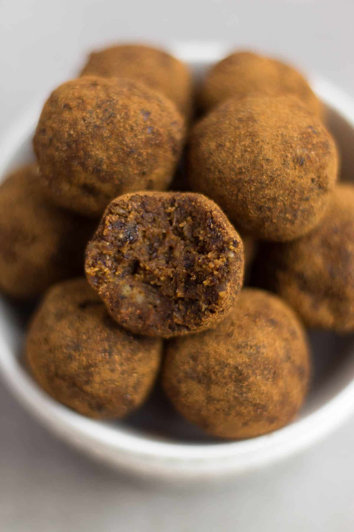 Classic fall flavors make their way into these Pumpkin Cinnamon Raisin Balls for the perfect snack or energy ball pick-me-up. Vegan, paleo, and Whole30 approved! - Eat the Gains