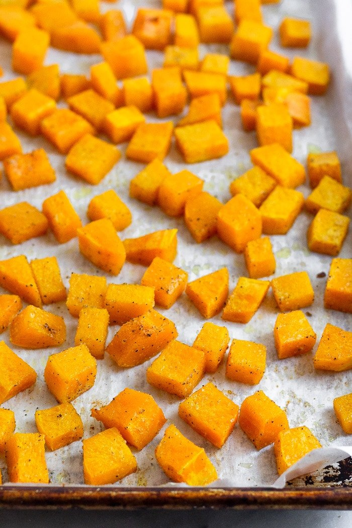 Baking sheet filled with cubed roasted butternut squash.