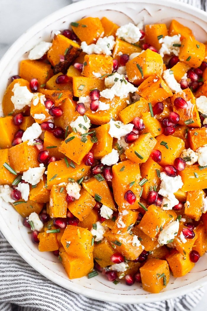Overhead shot of a bowl filled with a simple butternut squash salad.