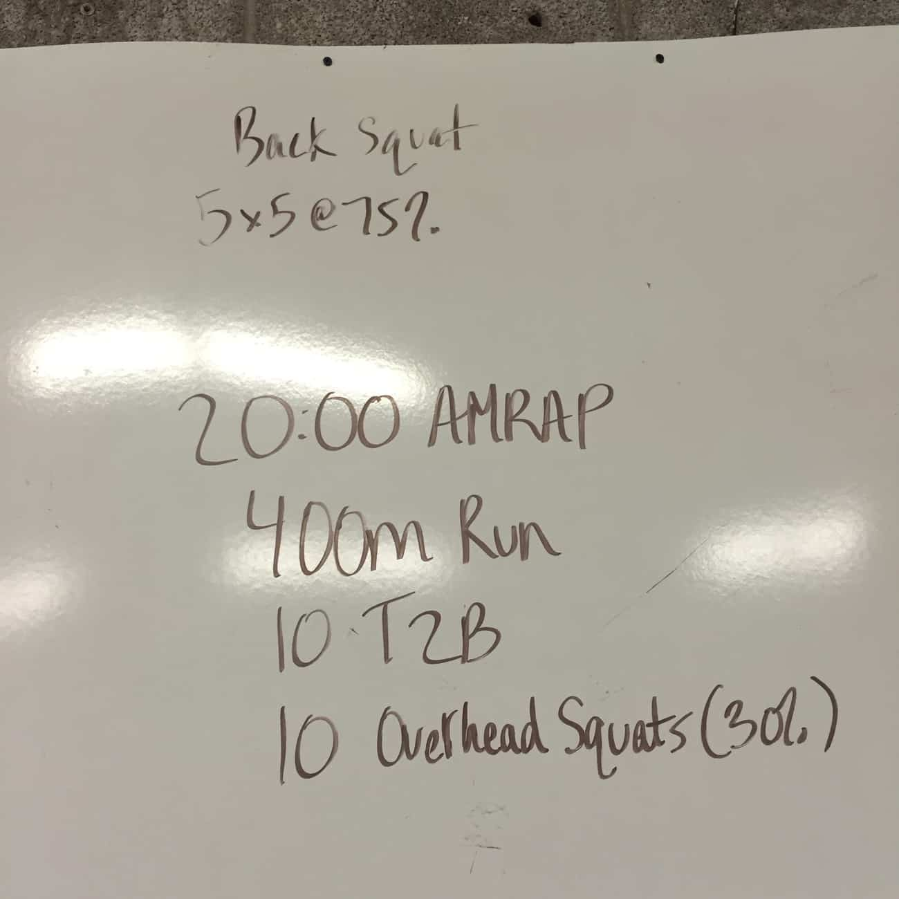A 20:00 AMRAP of running, toes 2 bar, and overhead squats to work on cardio endurance and your core strength.