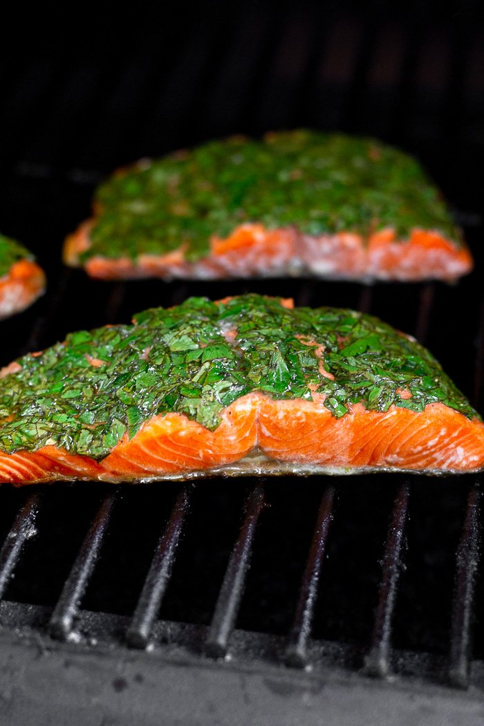 Salmon on the grill covered with fresh herbs.