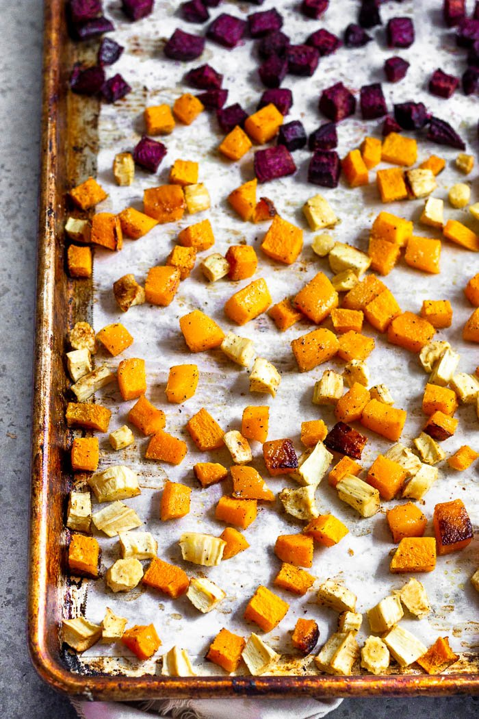 Pan of roasted butternut squash, parsnips, and beets.