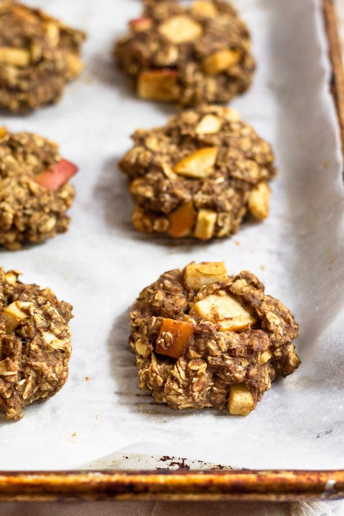 Homemade protein cookies on a baking sheet lined with parchment paper.