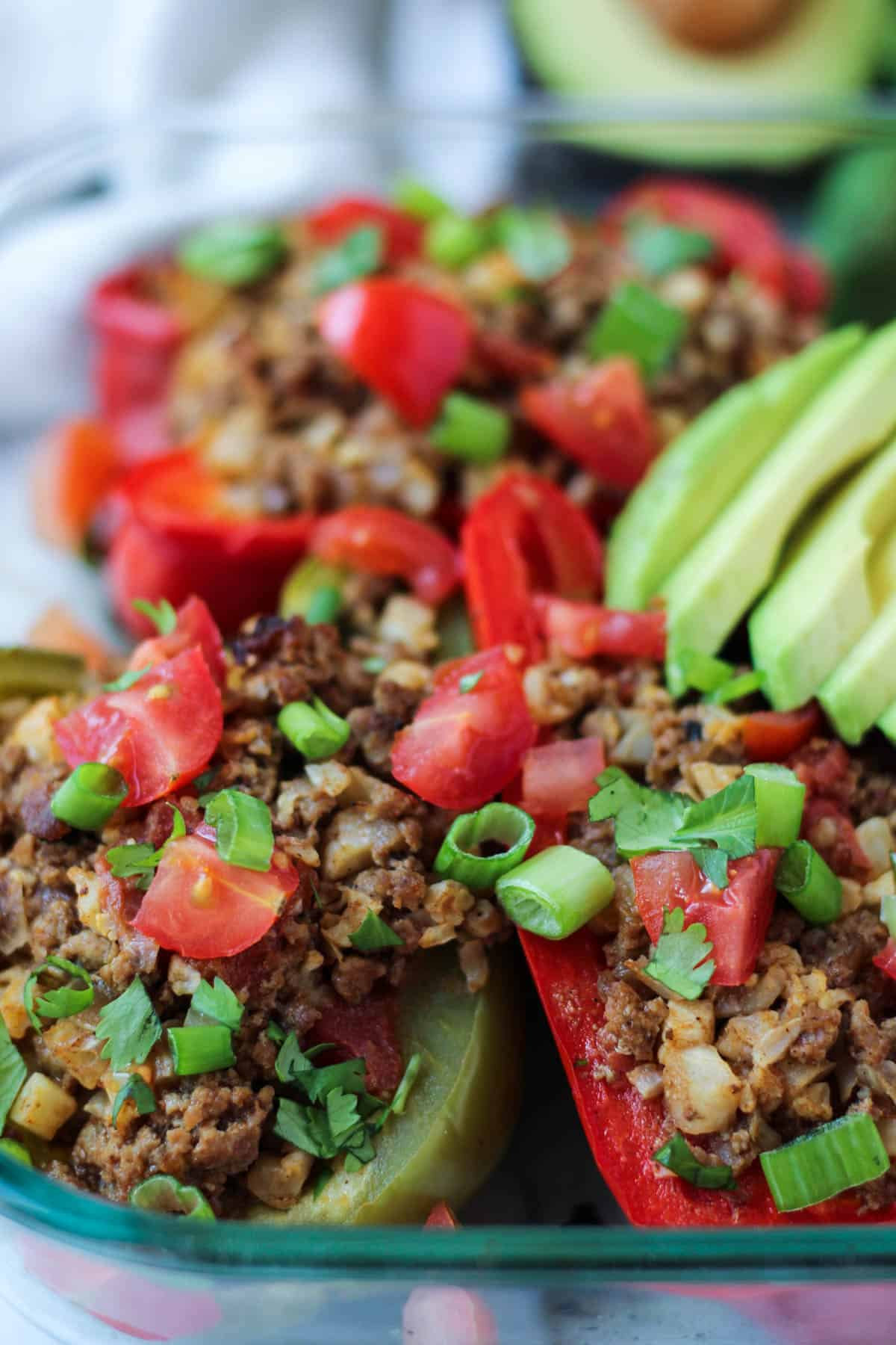 TheseBeef & Rice Stuffed Peppers are stuffed with cauliflower rice and Mexican spices for an easy paleo and Whole30 approved dish - Eat the Gains
