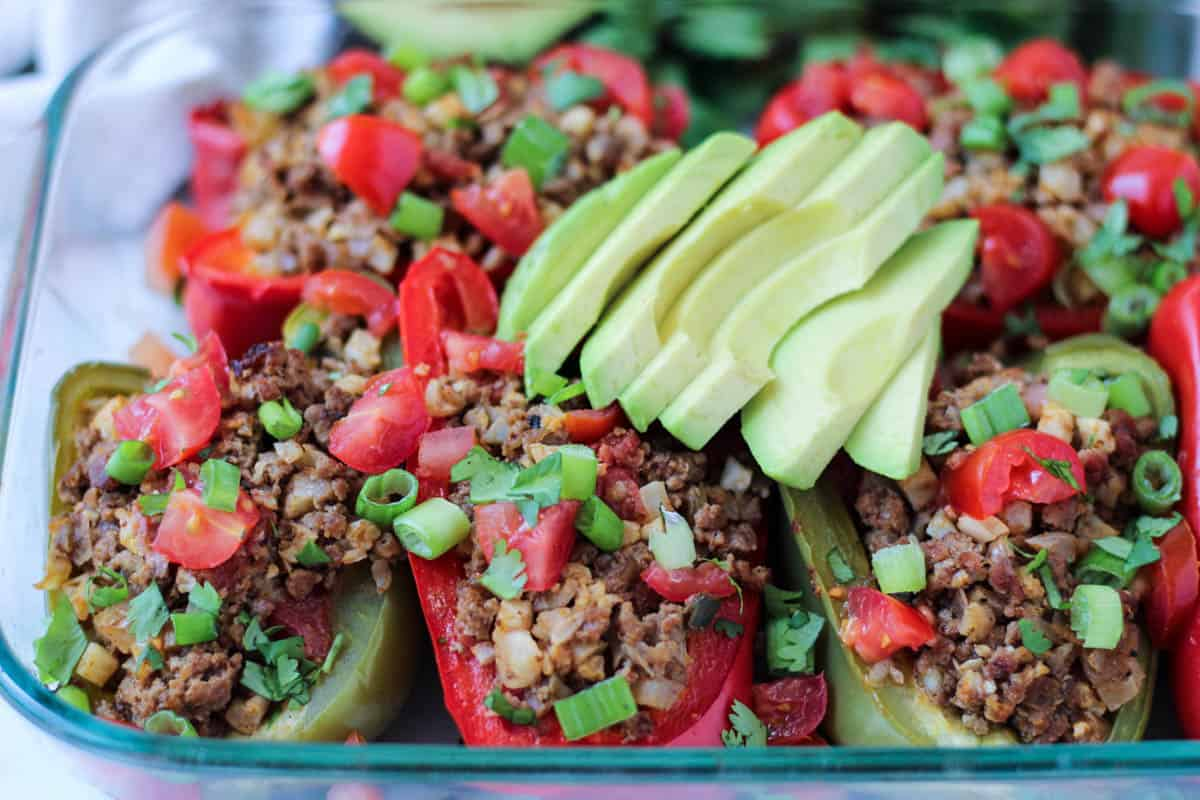 These Beef & Rice Stuffed Peppers are stuffed with cauliflower rice and Mexican spices for an easy paleo and Whole30 approved dish - Eat the Gains