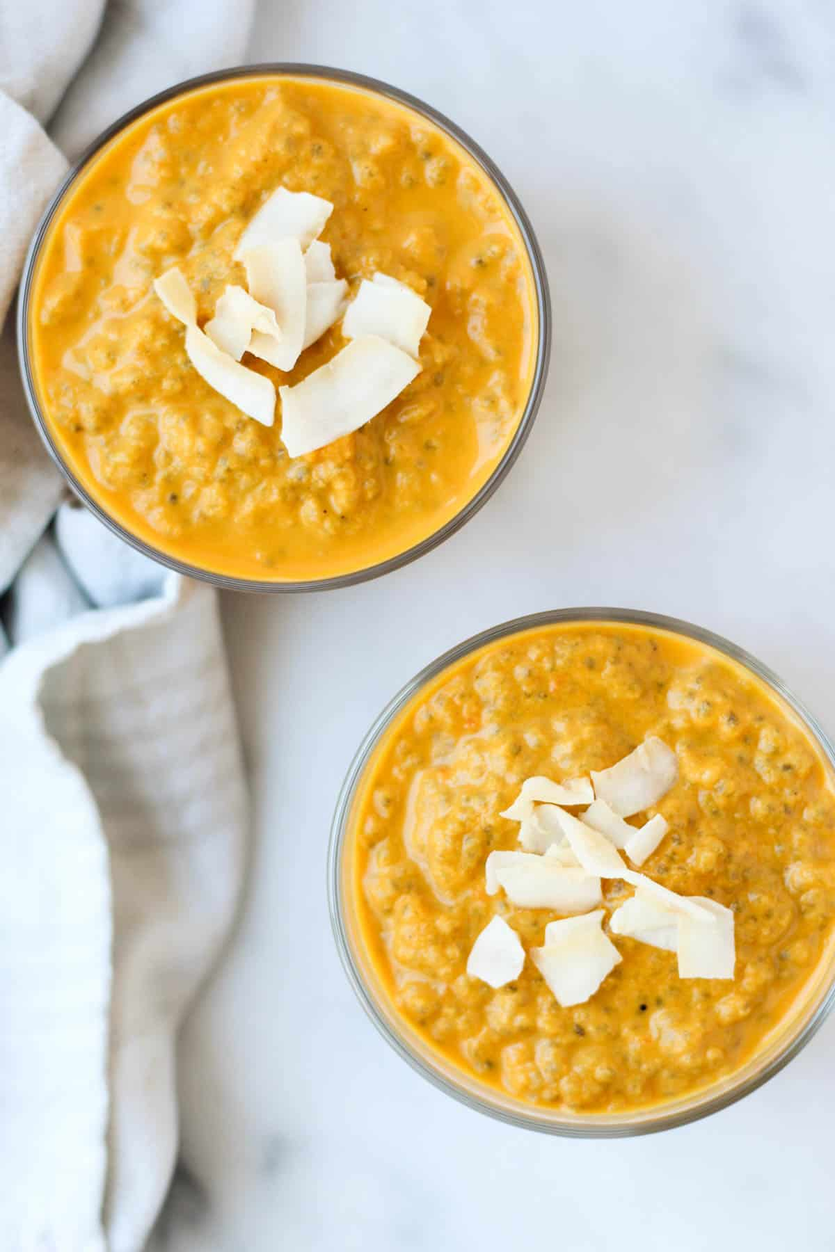 This Carrot Cake Chia Pudding takes the flavors of a classic dessert and turns it into a healthy snack that is paleo, vegan, and dairy & gluten free - Eat the Gains