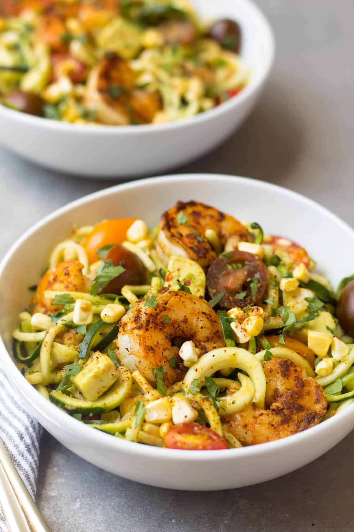 These Southwest Shrimp Zucchini Noodles are an easy and light summer dish packed with protein and seasonal vegetables. - Eat the Gains