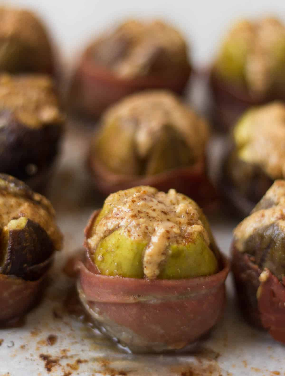 A perfect appetizer for fall, these Prosciutto Wrapped Figs are stuffed with almond butter for making a sweet & salty combo - paleo, Whole30, and gluten free! - Eat the Gains