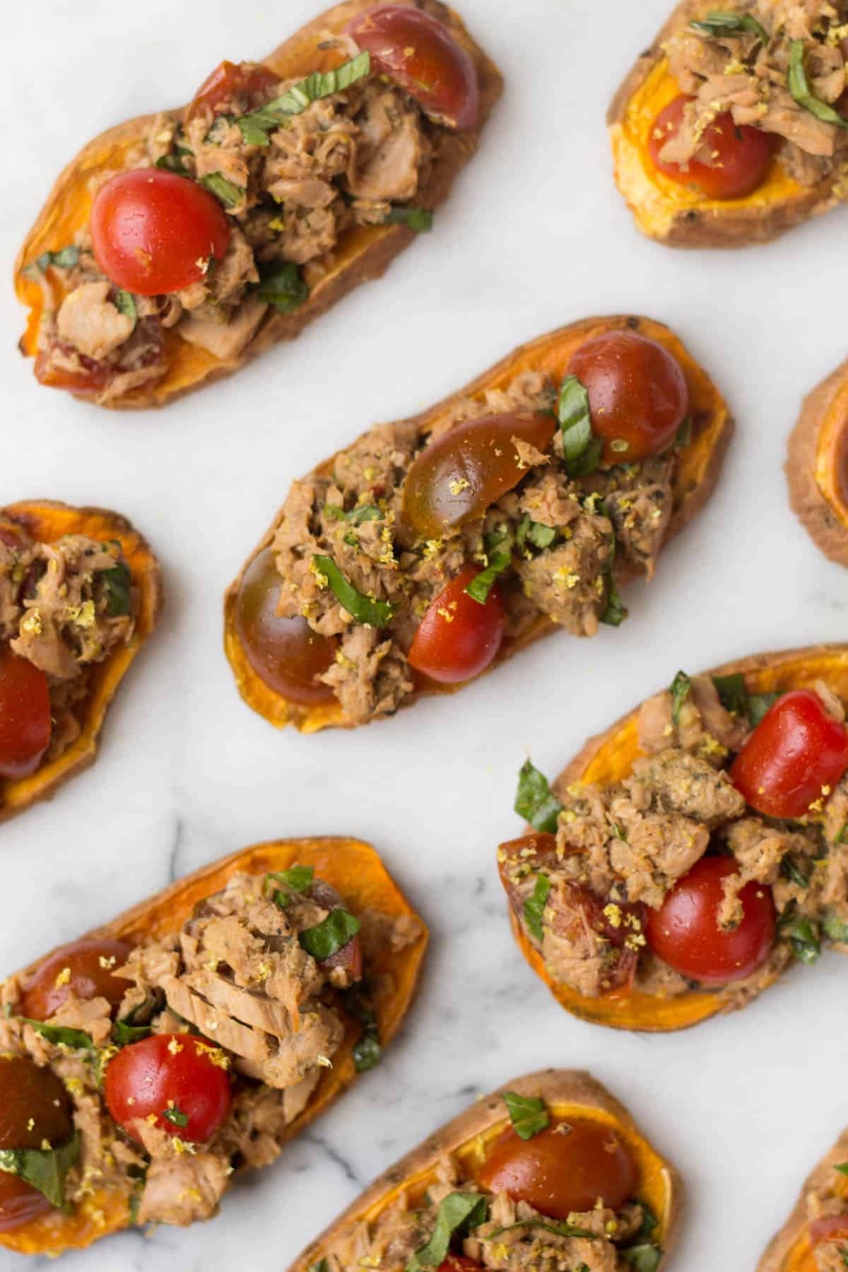 A paleo and Whole30 approved protein packed, this Tuna Bruschetta on Sweet Potato Toast makes easy, healthy, and crowd pleasing appetizer or snack! - Eat the Gains