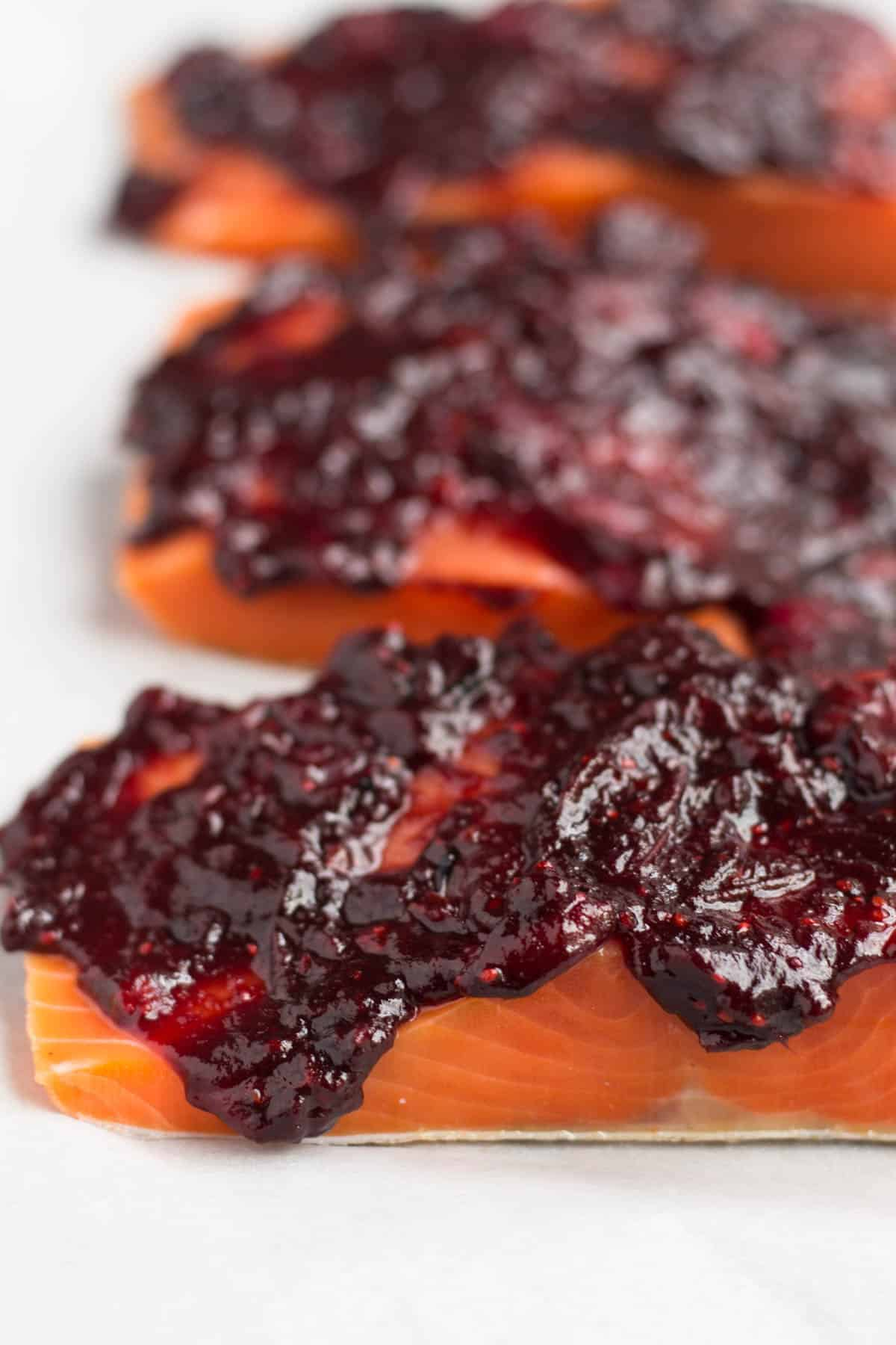 An easy and festive seafood dish, this Cranberry Balsamic Roasted Salmon takes 15 minutes, 4 ingredients, and is a crowd pleaser for the holidays - paleo and Whole30 approved! - Eat the Gains