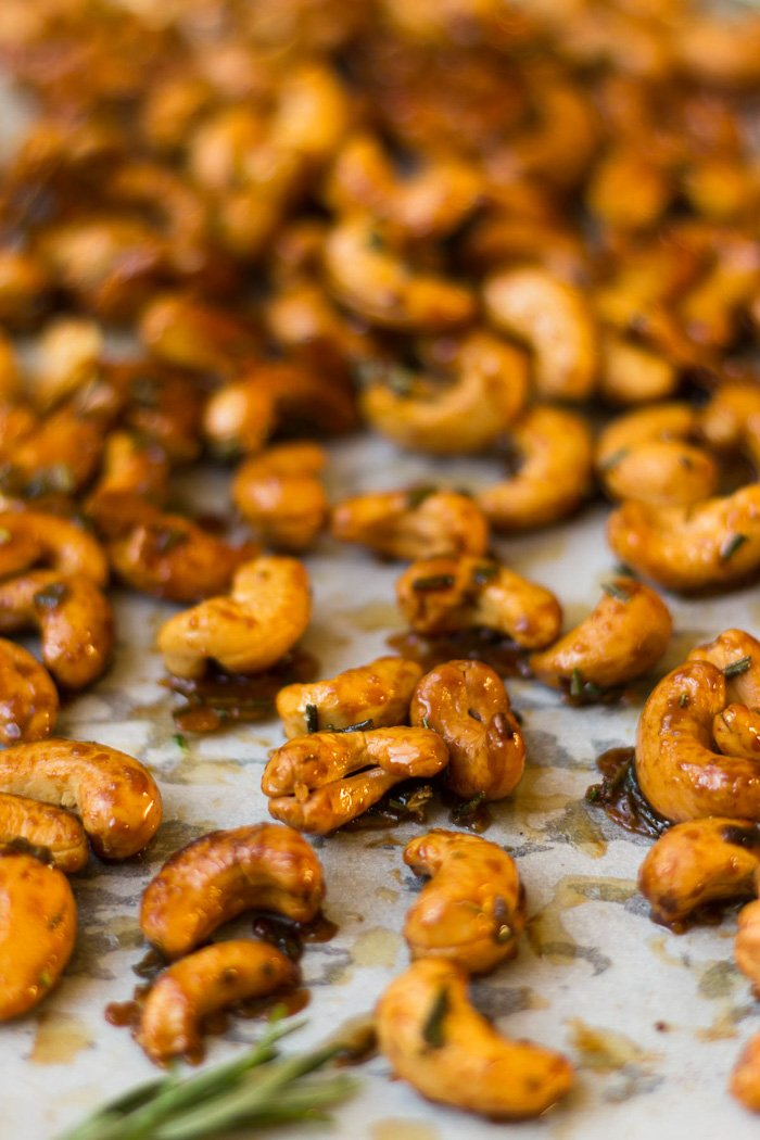 Sheet pan filled with freshly roasted honey rosemary cashews