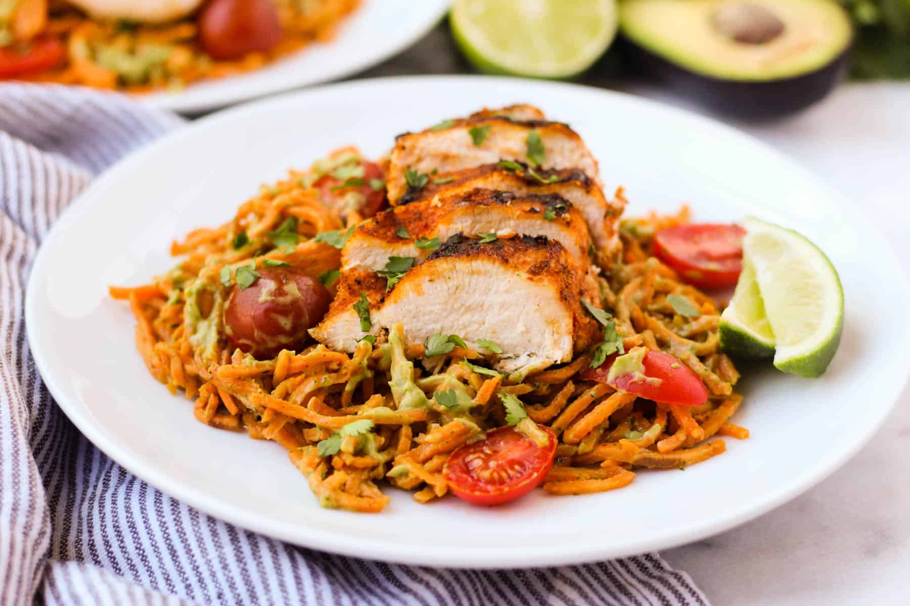 One pan & 30 minutes for this Chili Dusted Chicken & Sweet Potato Noodles with Avocado Sauce. Packed with protein, carbs, and healthy fats to make an easy gluten free, paleo, and Whole30 approved dish - Eat the Gains