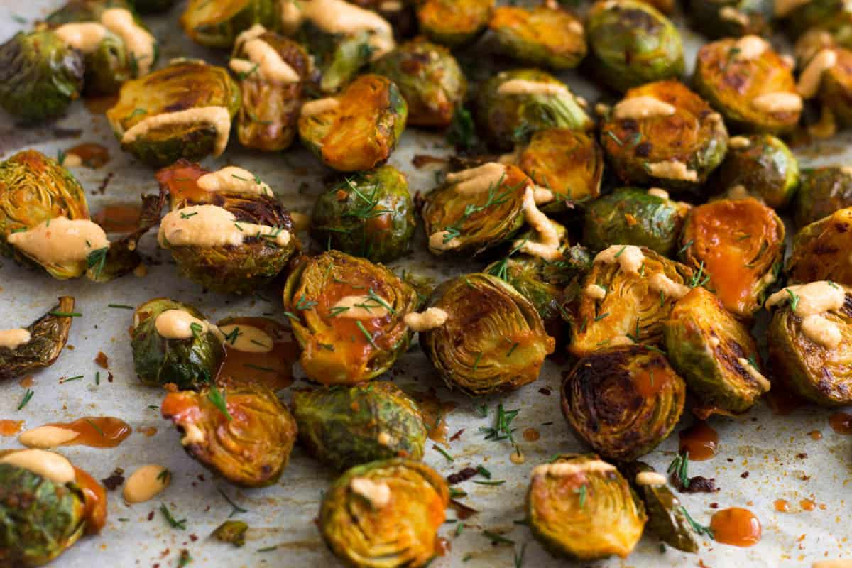 Close up of roasted cheesy buffalo brussel sprouts
