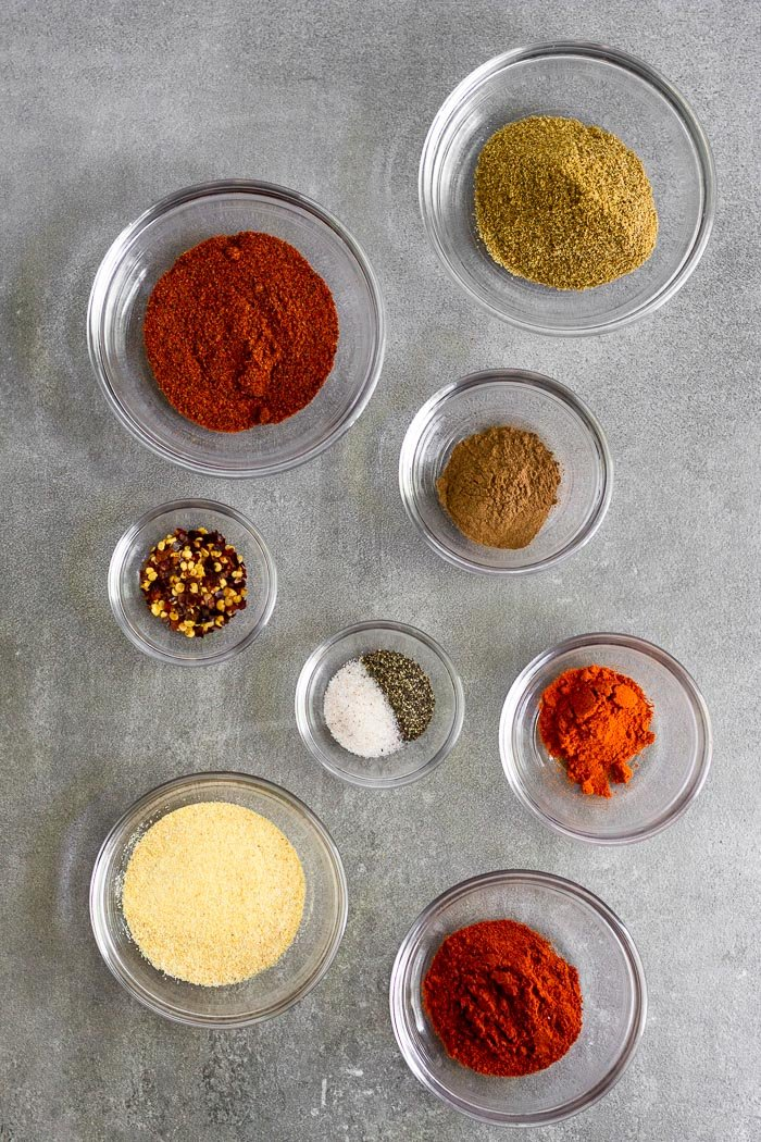 Grey counter filled with small bowls of spices for diy taco seasoning