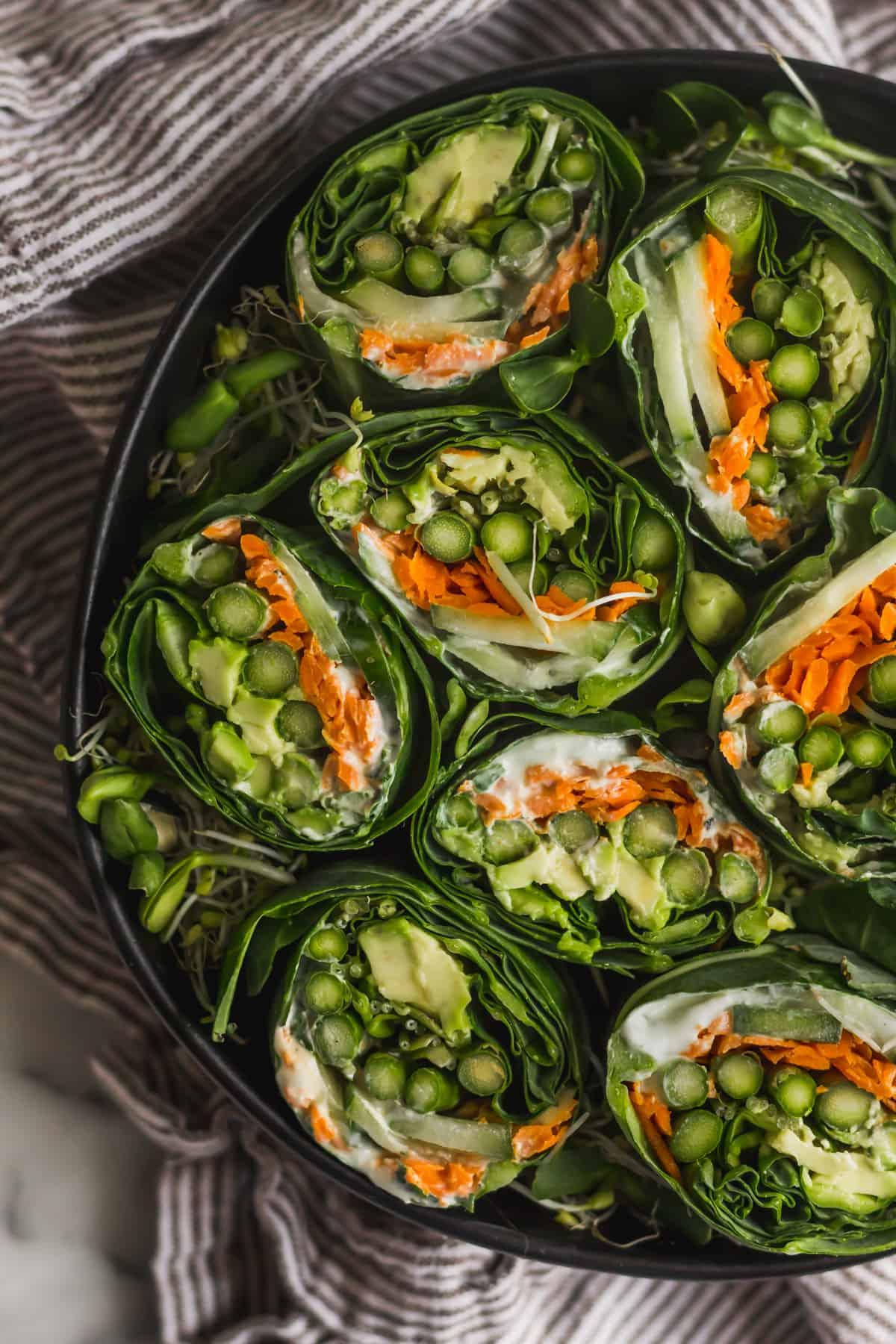 Large bowl filled with veggie collard wraps