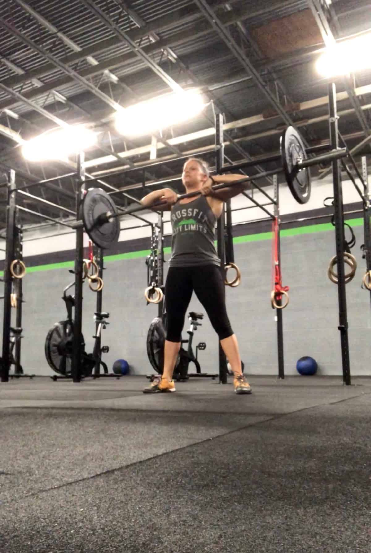 Girl doing a sumo deadlift high pull