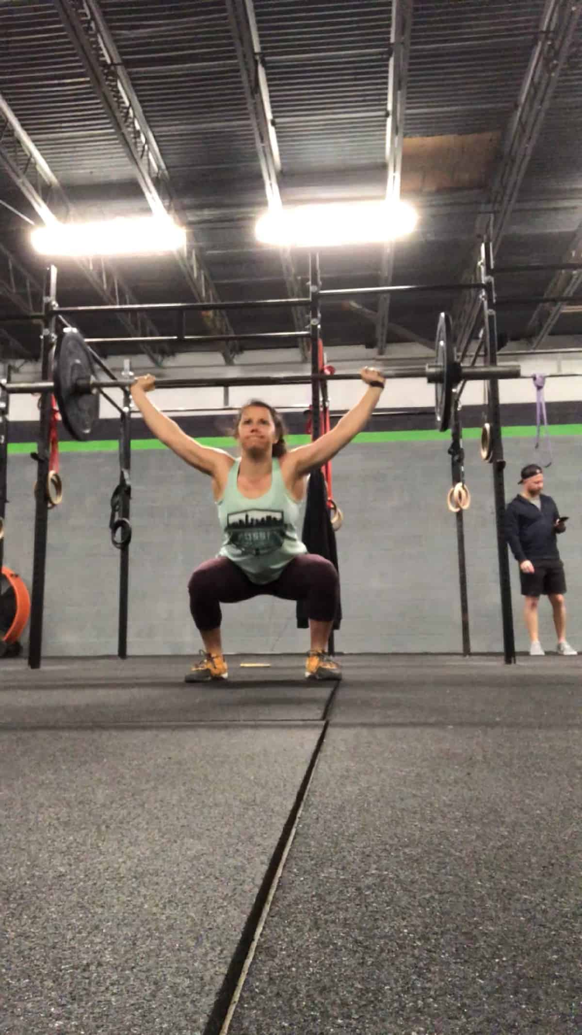 Girl doing an overhead squat