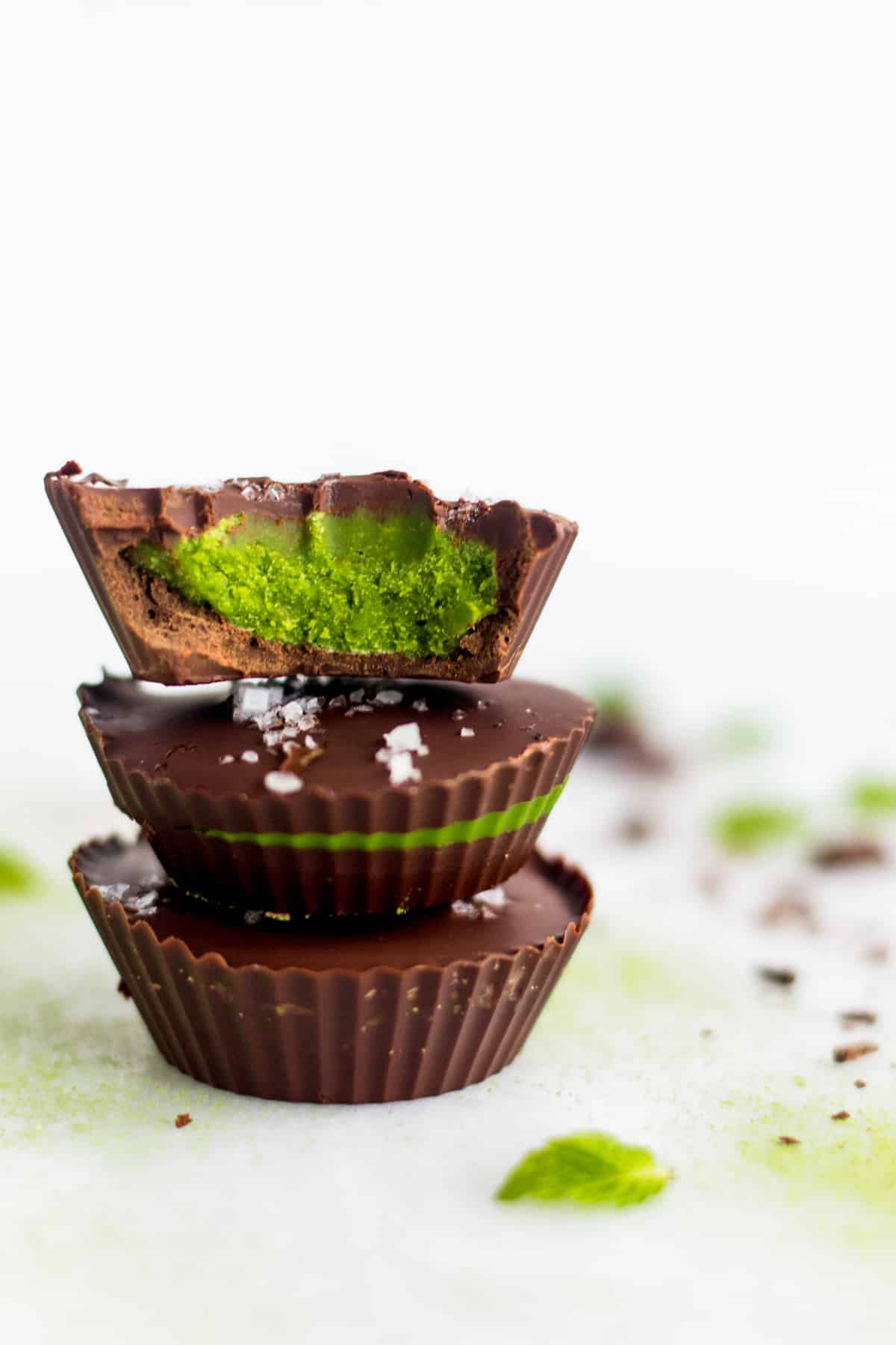 3 Collagen Mint Matcha Coconut Butter Cups stacked on top of each other