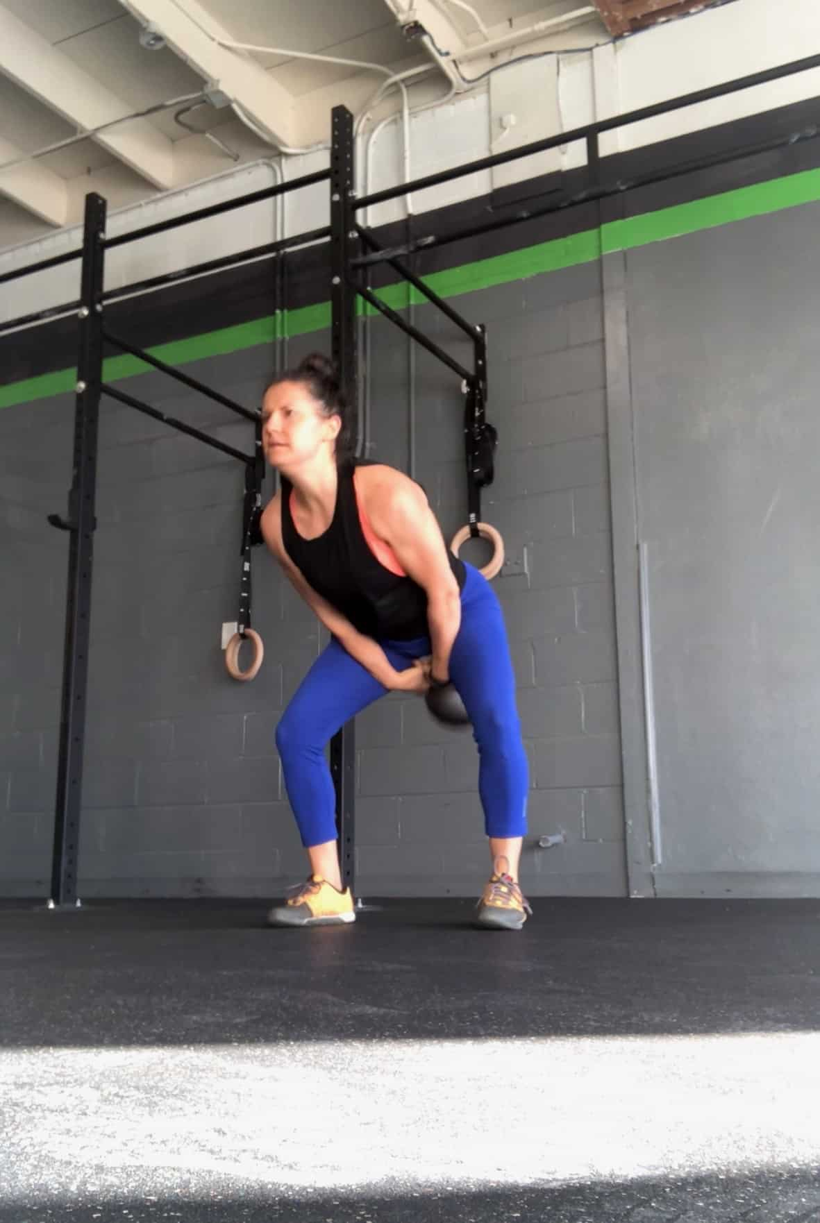 Girl doing a heavy kettleswing