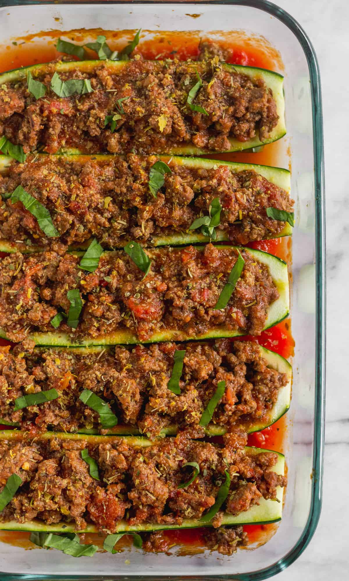 Pan filled with 5 zucchini boats stuffed with Italian seasoned beef