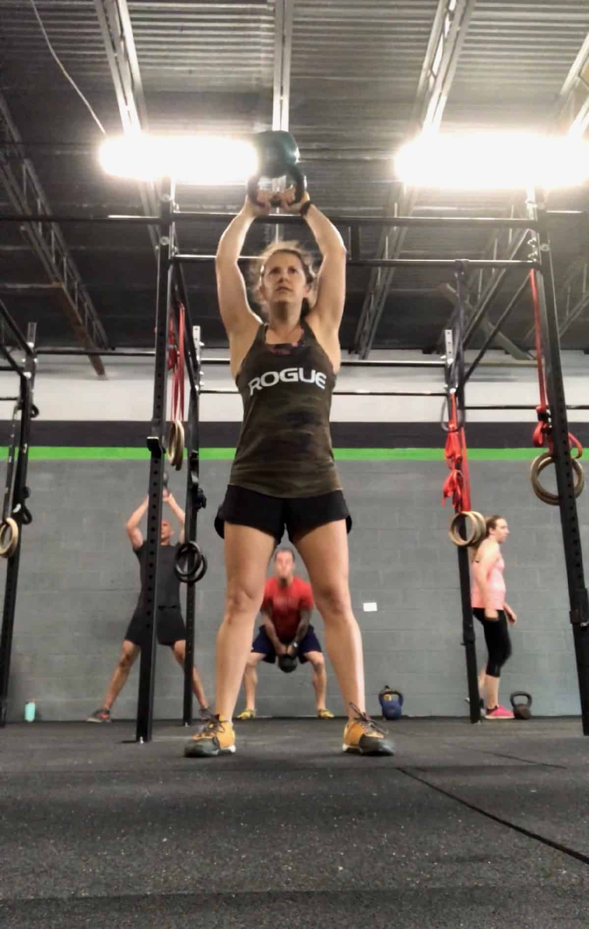 Girl doing a kettlebell swing