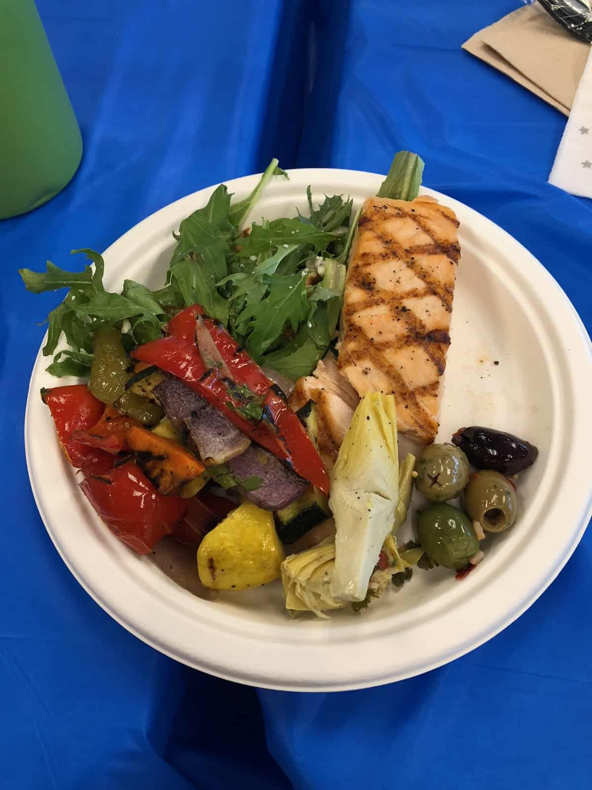 Catered lunch of salad, roasted veggies, salmon, and olives