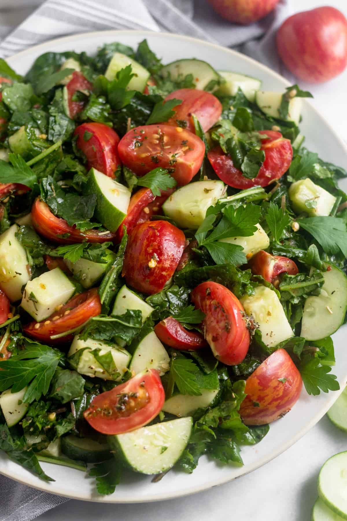 Large white plate of Chopped Tomato Cucumber Kale Salad
