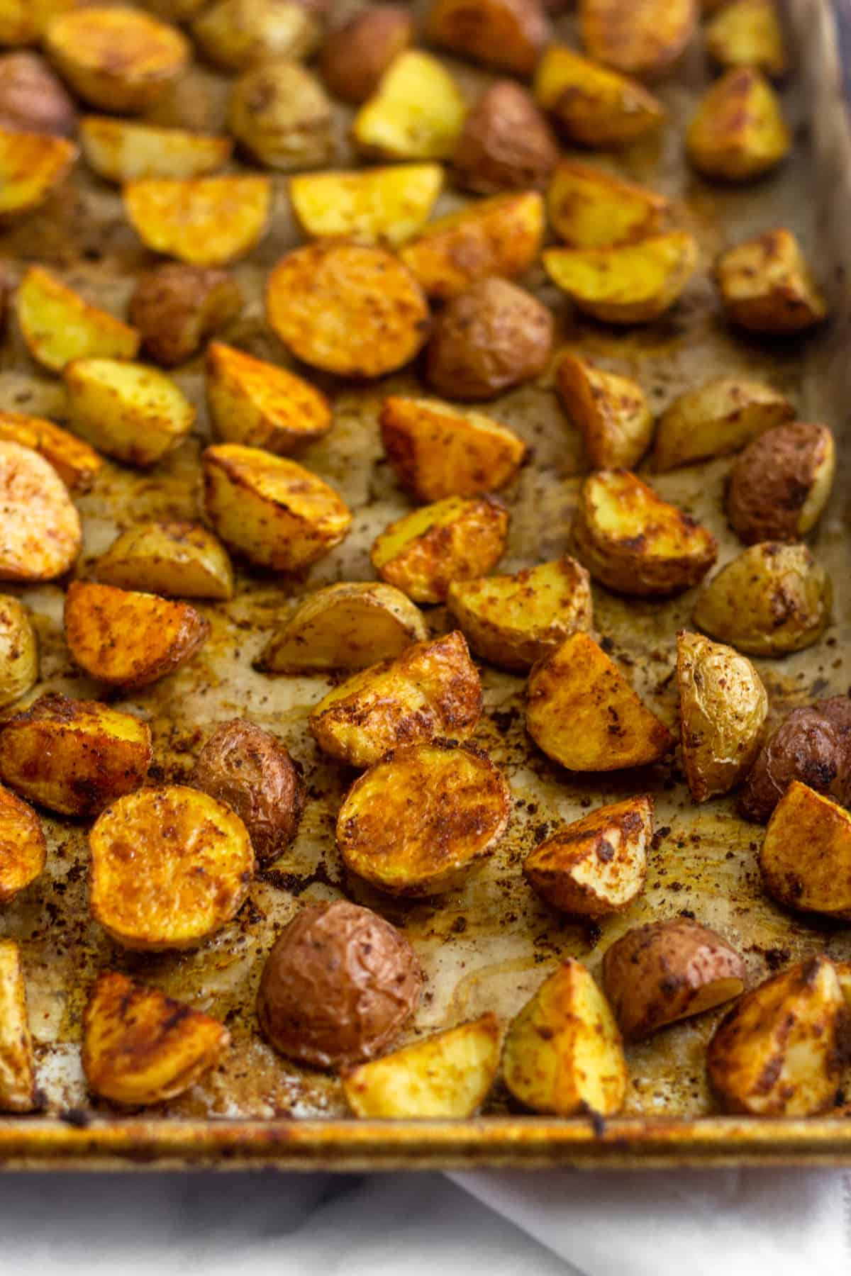 Baking sheet filled with golden brown crispy roasted breakfast potatoes