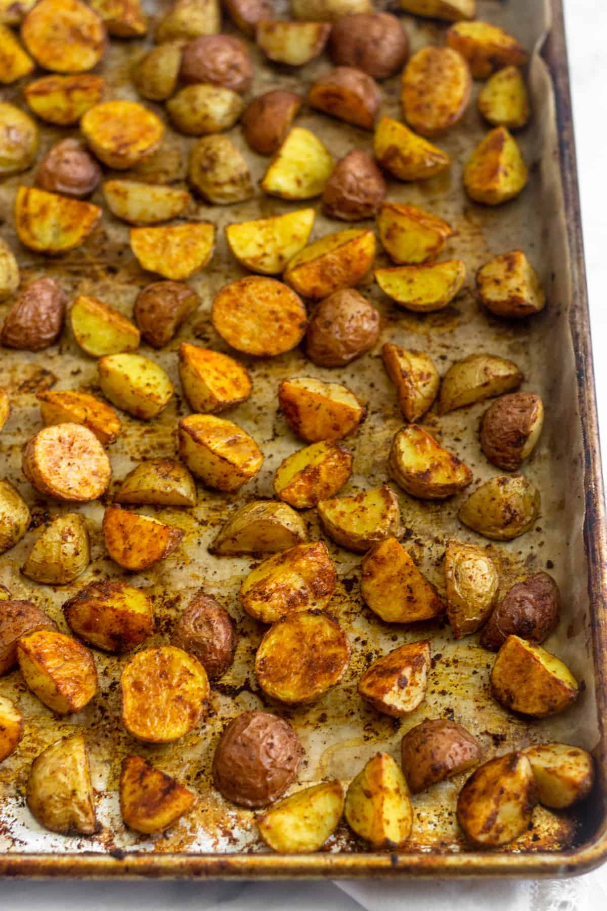 Large baking sheet filled with crispy roasted breakfast potatoes right out of the oven