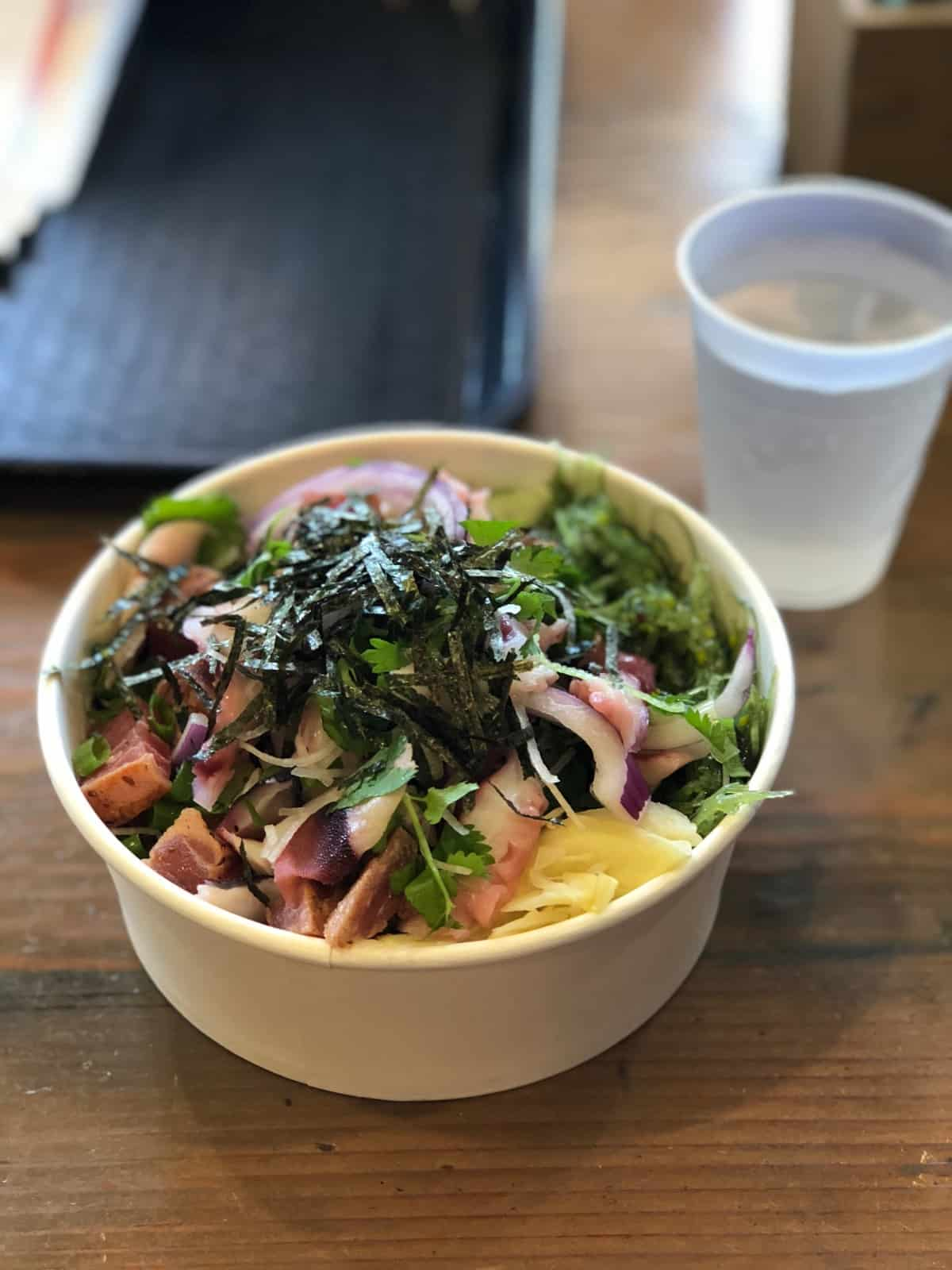 Poke bowl with tuna and octopus, seaweed salad, and ginger from Poke Chop in San Diego, CA