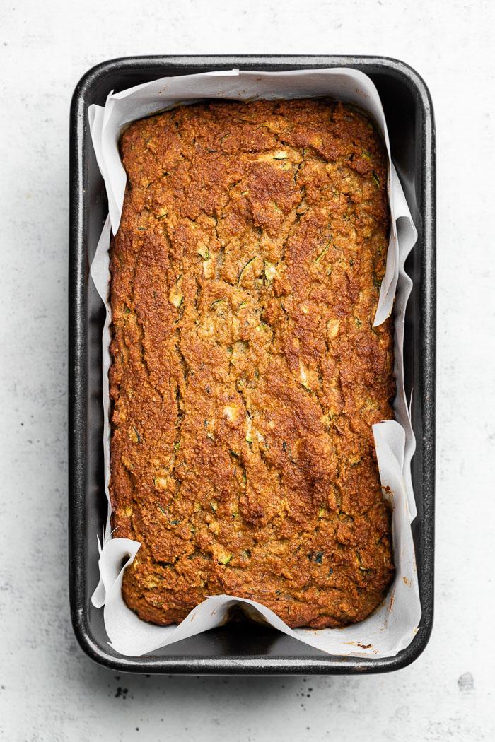 Overhead shot of paleo zucchini banana bread in a bread loaf pan.