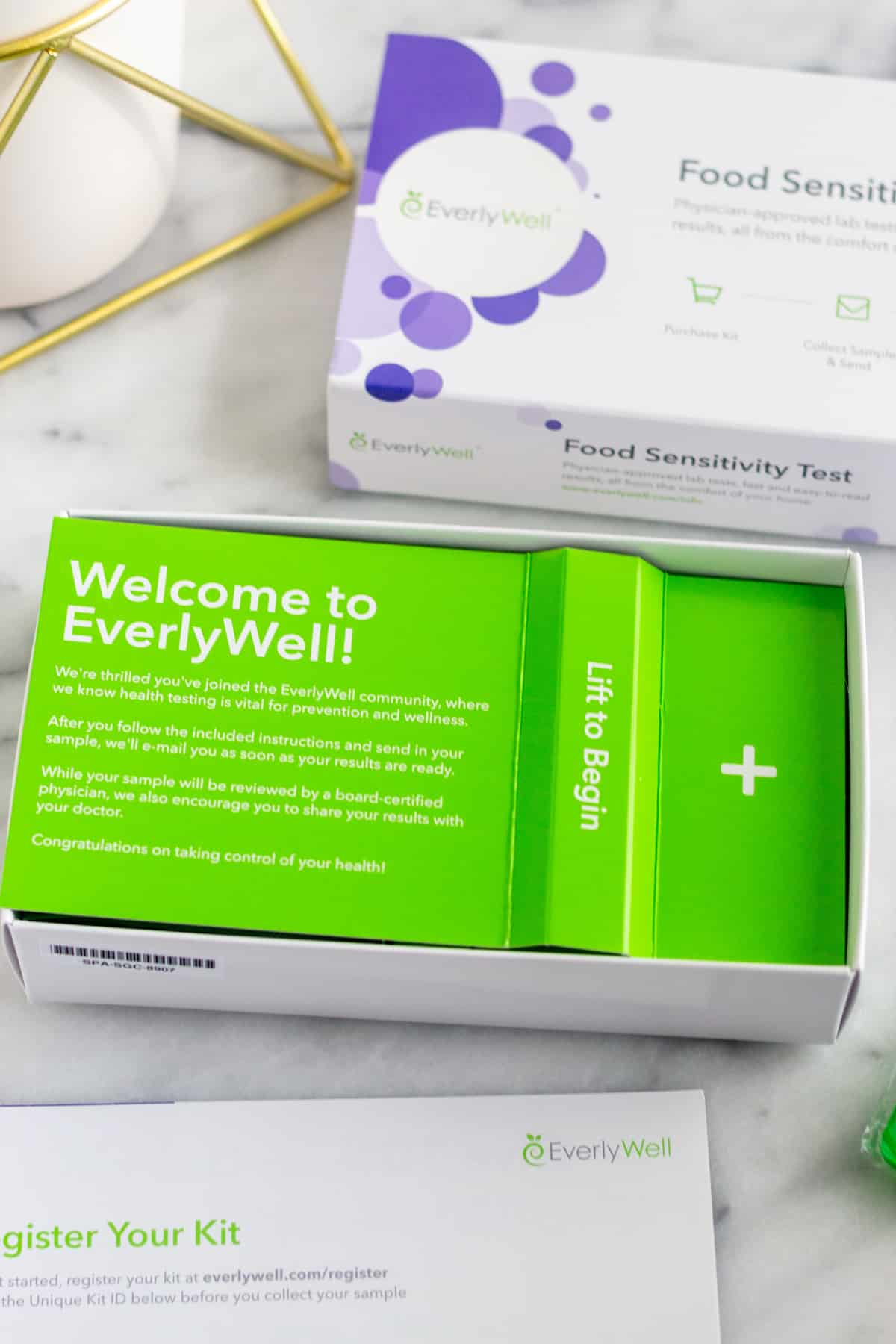 EverlyWell Food Sensitivity test box open on a white counter