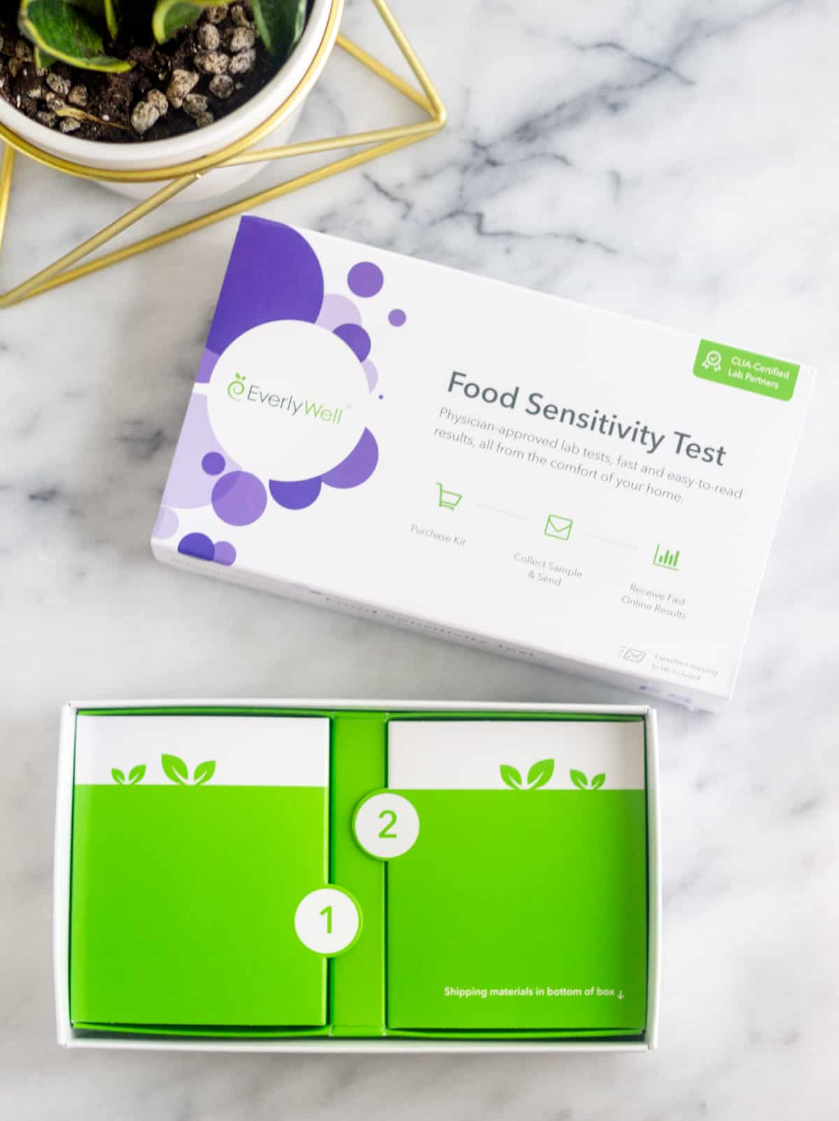 EverlyWell Food Sensitivity test box open on a white counter with the first steps in the box