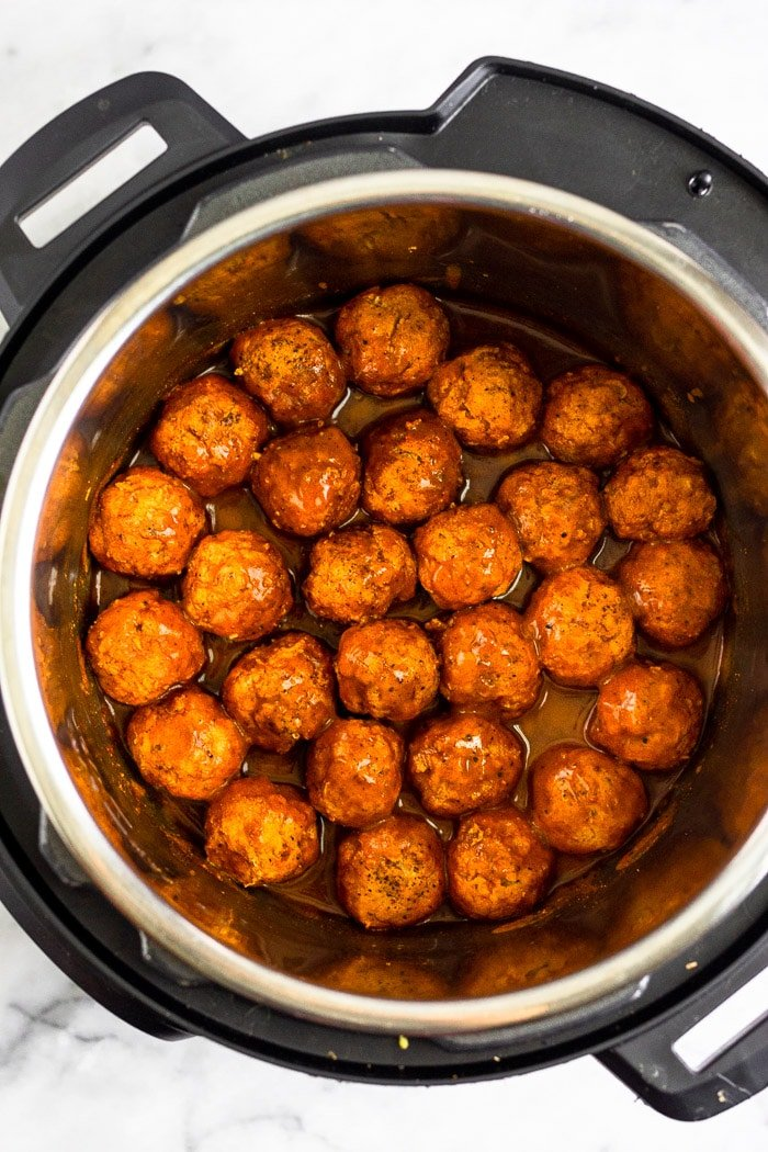 Instant Pot filled with Whole30 chicken meatballs covered in BBQ sauce.