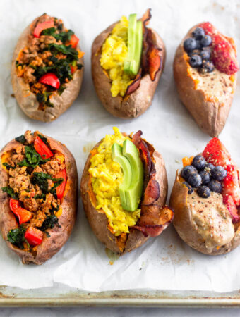 Overhead shot of six stuffed sweet potatoes to make sweet potato breakfast 3 different ways.