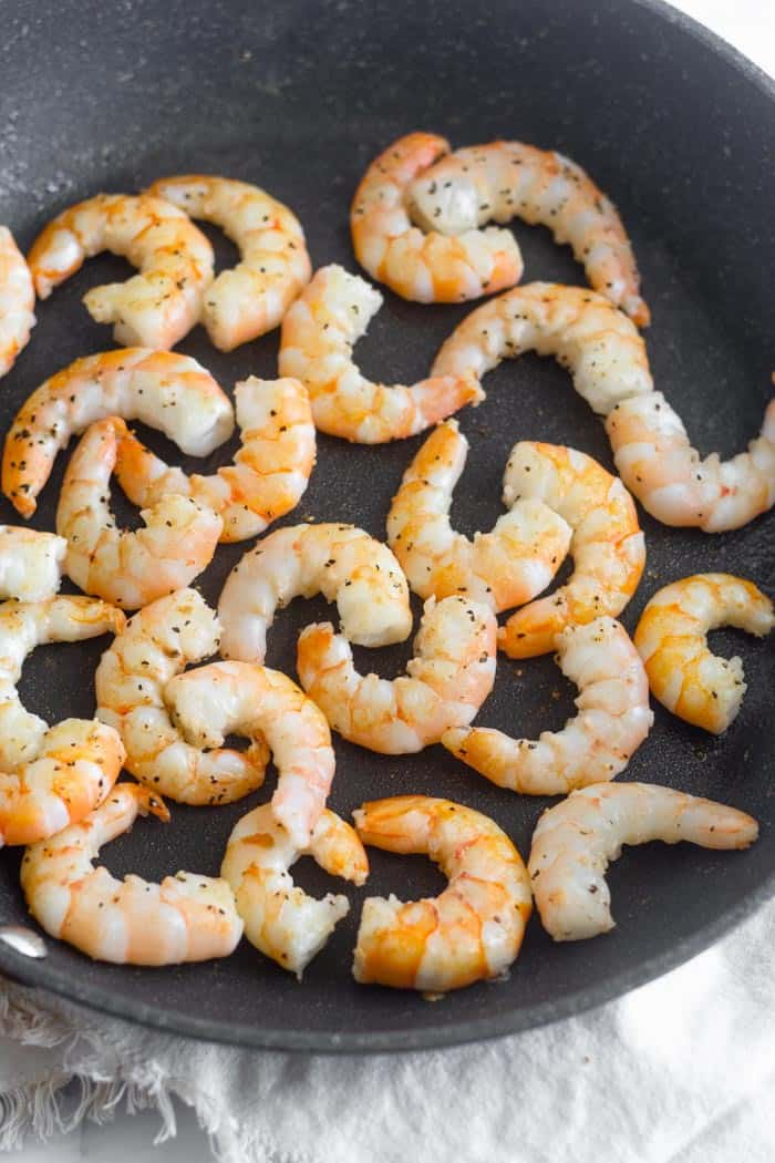 A large pan of cooked shrimp