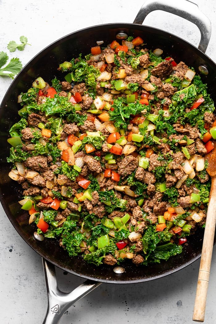 Overhead pan filled with sautéed ground beef and veggies.