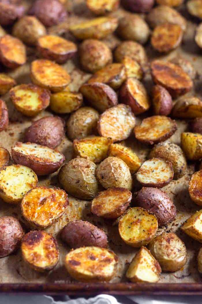 Large baking sheet full of crispy roasted potatoes