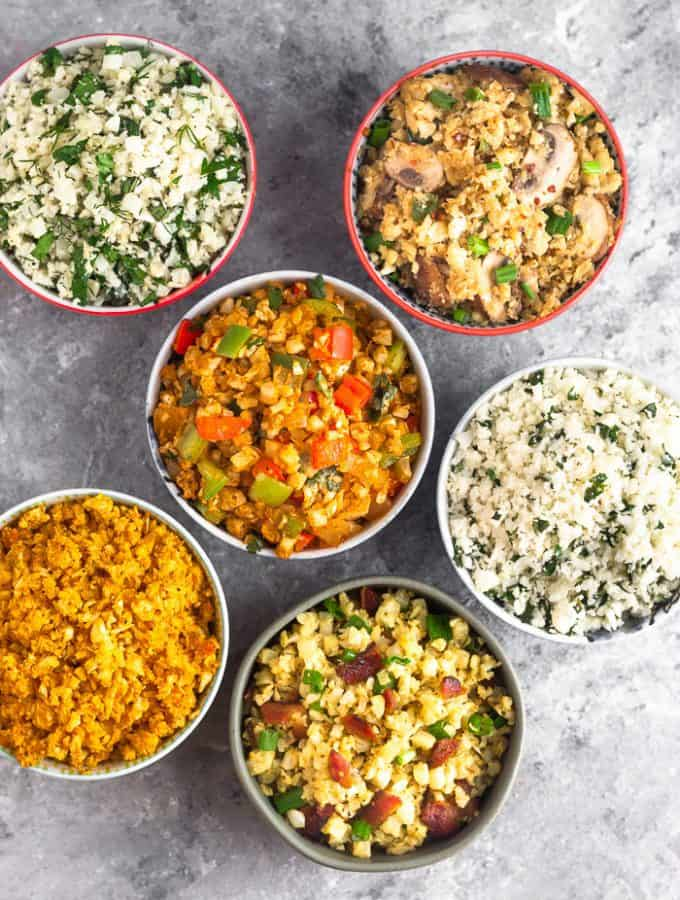 Overhead shot of 6 different bowls filled with 6 different paleo and Whole30 cauliflower rice recipes.