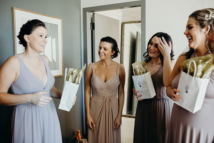 A group of bridesmaids getting laughing and ready for a wedding.