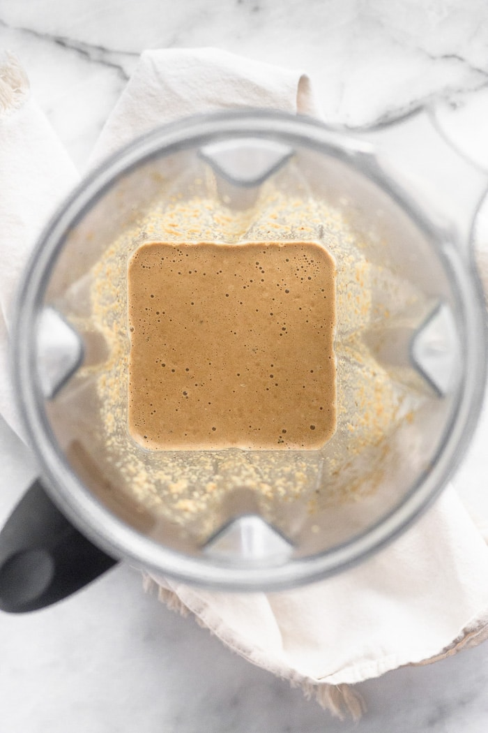 Blender filled with creamy balsamic dressing.