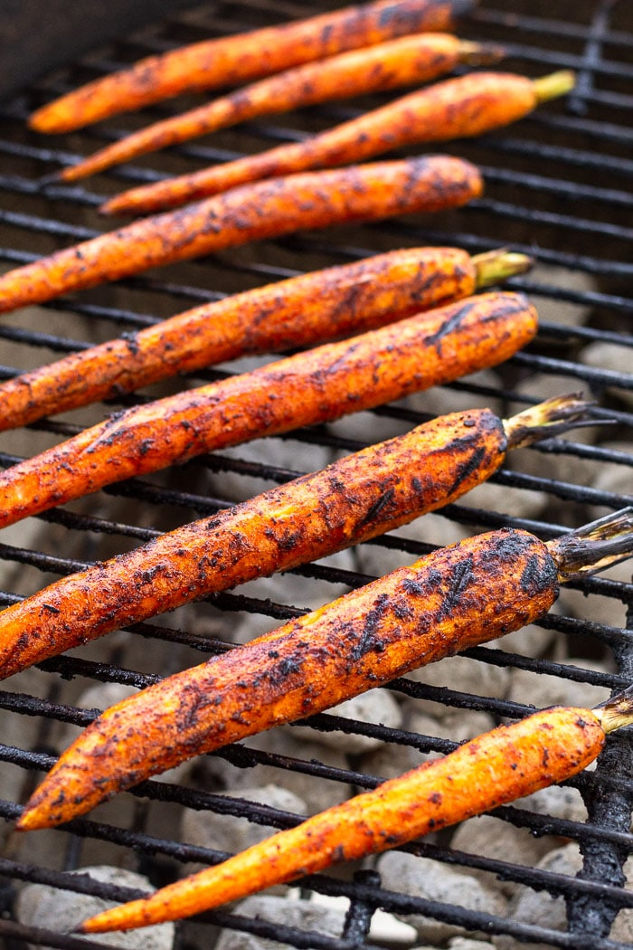 Glazed grilled carrots on the grill.