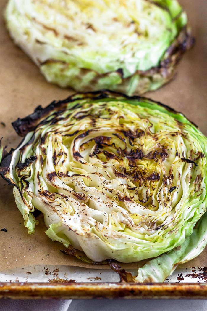 Close up of a grilled cabbage steak with grill marks on it.