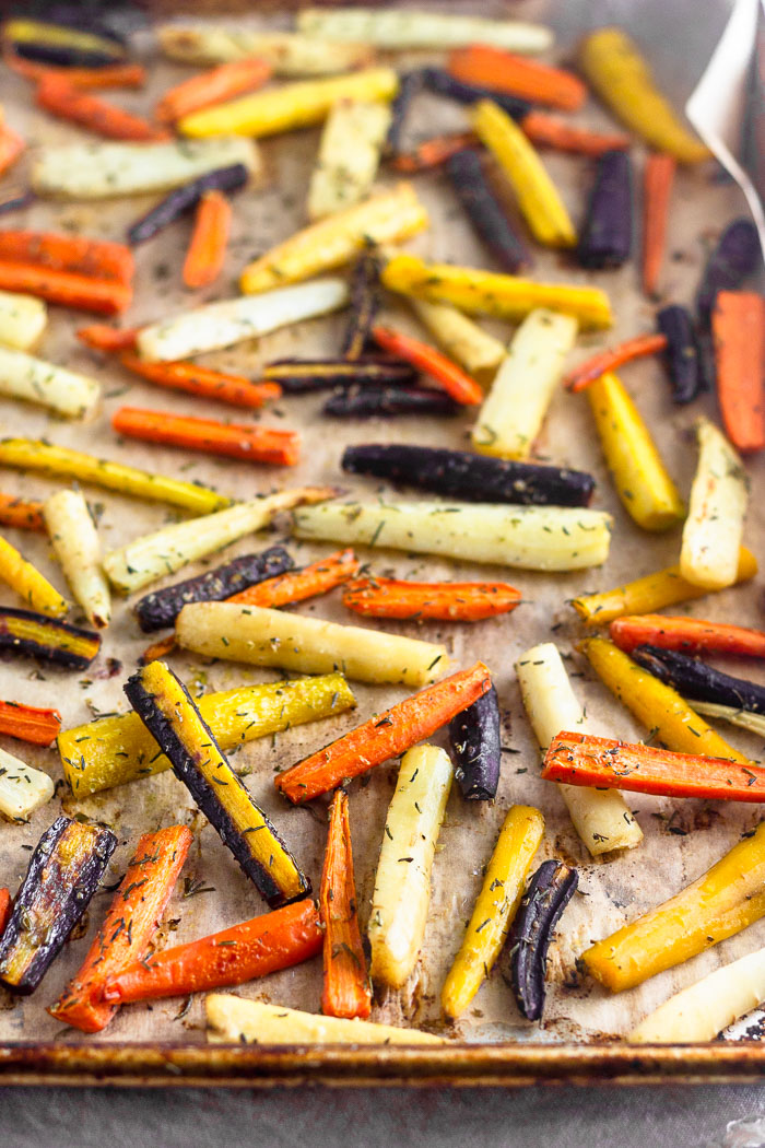 Large baking sheet filled with rainbow roasted carrots.
