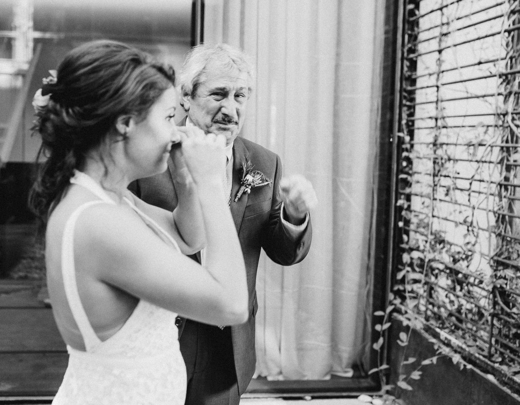 Father and daughter crying on her wedding day.