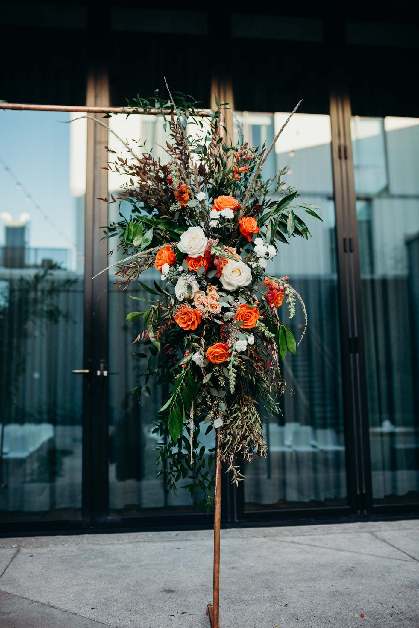 Flowers on a brass arch in a wedding.