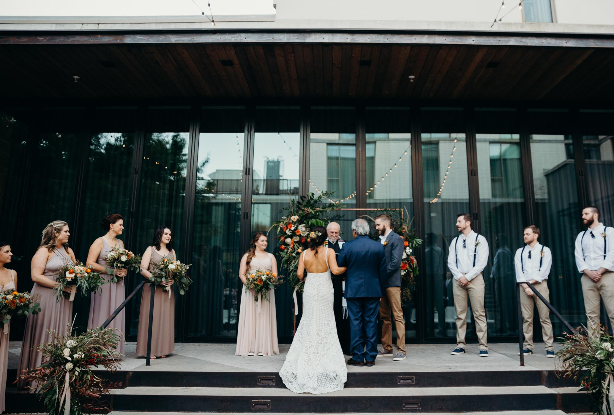 Dad giving off his daughter to her soon to her husband on her wedding day.