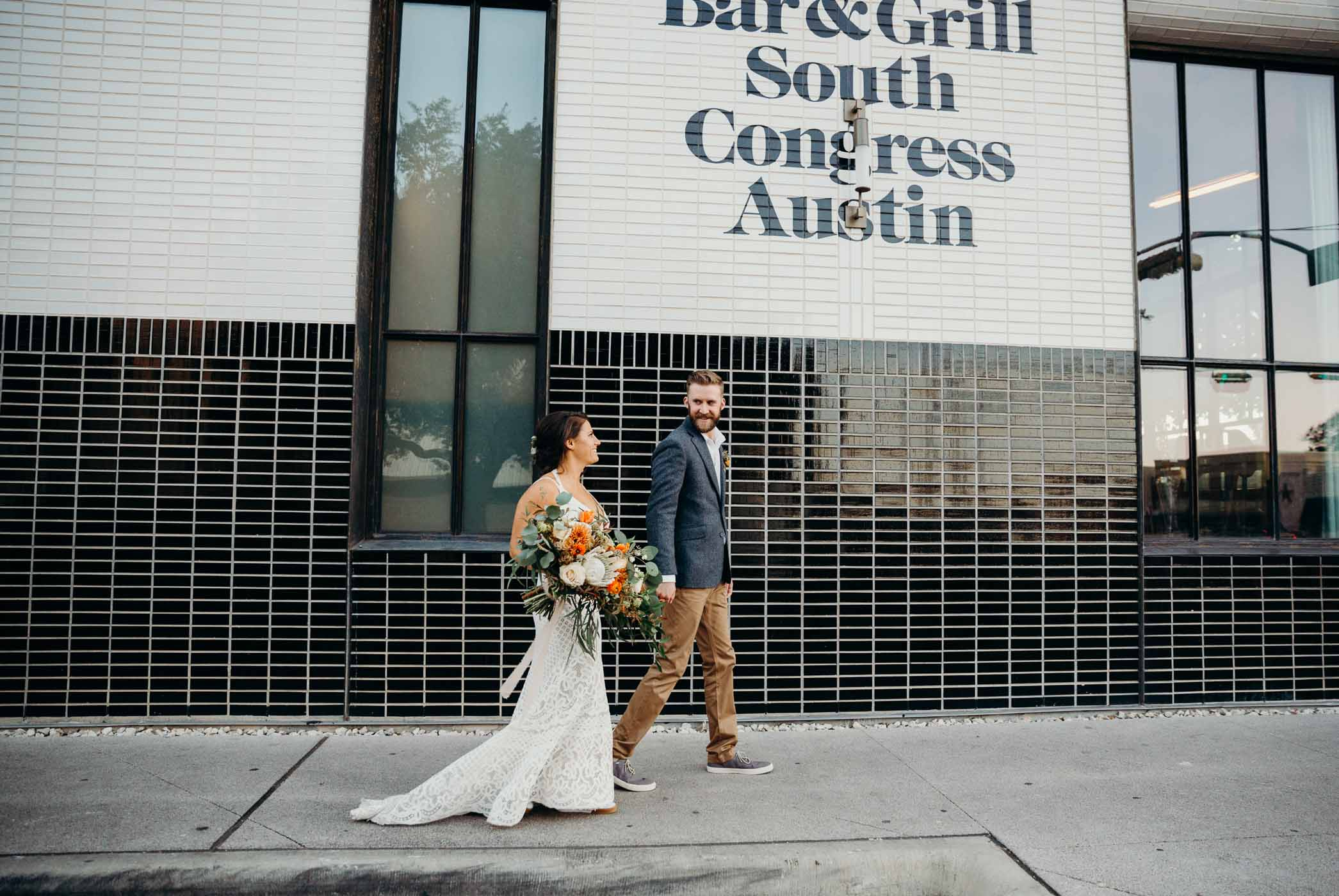 Bridge and groom walking on South Congress Avenue in Austin right after they got married.