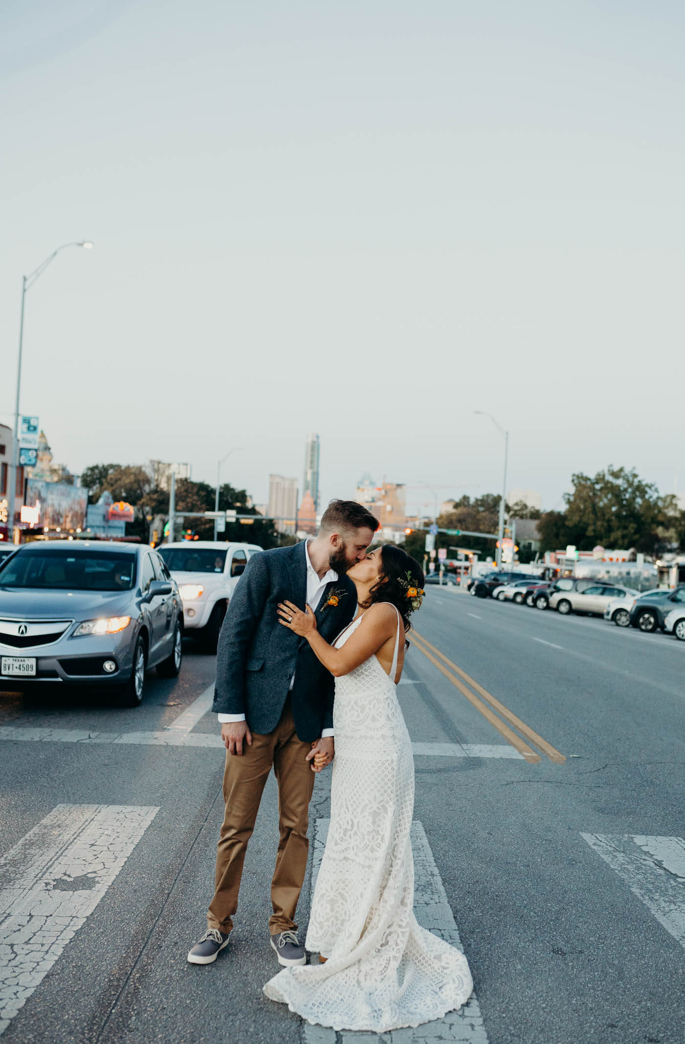 Bridge and groom kissing in the middle of South Congress Street right after they were married.