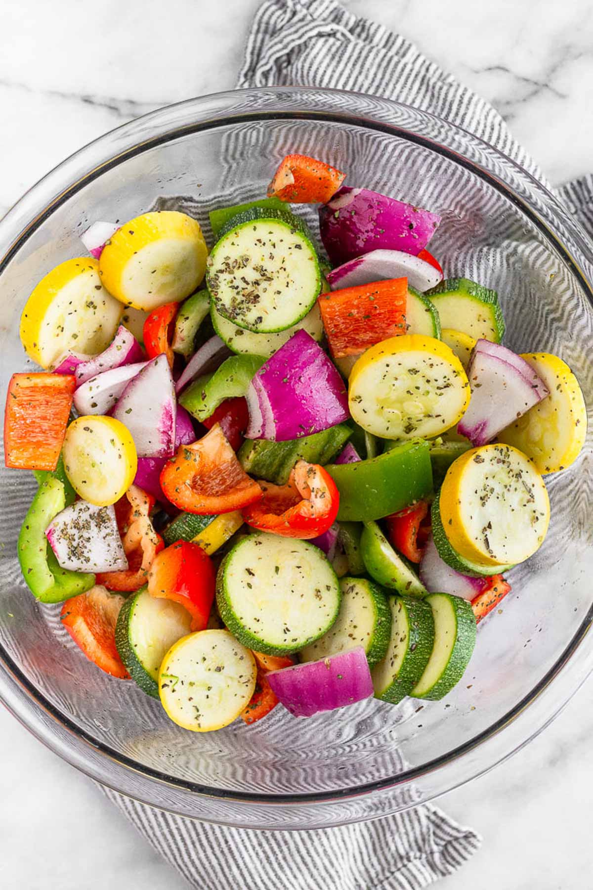 Raw Greek Chicken Skewers on a baking sheet lined with parchment paper.